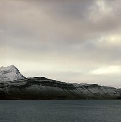 one more view across the fjord (lawatt) Tags: cliff mountain 120 film water iceland fjord djúpavík westfjords reykjarfjördur árneshreppur hasselblad 400 portra 120mm