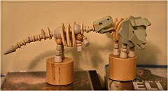 Dystopian conflict (krillmerma) Tags: wooden toys trex triceratops book eli