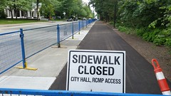 Opening soon, new sidewalk and cycling path (D70) Tags: openingsoon new sidewalk cyclingpath borrowed sign cityhall footpath blue barriers closed pattersonstreet burnaby britishcolumbia canada redandwhite cone plastic