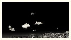 Small Clouds... (Ody on the mount) Tags: alpen berge canon filmkorn g7xii minimalismus powershot rahmen urlaub wolken bw blackandwhite clouds frame grain minimalism monochrome mountains sw schwarzweis sepia österreich vandans vorarlberg