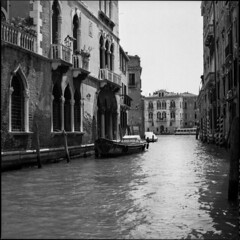 Venezia #10 (BG Sixtyniner) Tags: venezia italia canal boat gondola water sea city ancient historic architecture old town analog film bw blackwhite roll mediumformat 120 square 6x6 ilford delta400 perceptol stock homedev paterson hasselblad500cm carlzeiss planar f28 80mm vuescan canoscan9000f