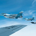F-16 Fighting Falcons fly in the Joint Pacific Alaska Range Complex beside a KC-135 Stratotanker