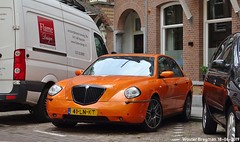 Lancia Thesis 3.0 V6 24V automatic 2003 (XBXG) Tags: 41lnkt lancia thesis 30 v6 24v automatic 2003 lanciathesis orange bva automatique vanbreestraat museumkwartier amsterdam nederland holland netherlands paysbas youngtimer italian car auto automobile voiture ancienne italienne italie italia italy vehicle outdoor