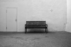 empty bench . (helmet13) Tags: leicaxvario bw minimalist bench emptybench wall door simplicity silence contemplation blaubeurenabbey aoi peaceaward world100f