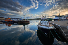 Evening reflections in Kirkwall Harbour (Mister Electron) Tags: orkney orkneyislands highlandsandislands scotland kirkwall kirwallharbour harbour marine boats lifeboat ship reflections evening still mirror clouds cloudscape landscape seascape ultrawideangle