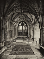 Norwich Cathedral Cloisters Entrance (Ian Smith (Studio72)) Tags: rx100 sonyrx100 sony uk england norfolk norwich norwichcathedral cathedral cloisters architecture entrance door doorway sepia medieval historic graves ornate building studio72