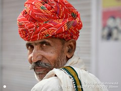 2018-11b Pagari (08) (Matt Hahnewald) Tags: travel people face wearing smiling eyes respect humanity head expression character culture moustache concept turban dignity stubble authenticity consent lookingatcamera pagri pagari facingtheworld matthahnewaldphotography street portrait india man colour male horizontal closeup rural asian person photography photo asia outdoor indian traditional manly 85mm posing lifestyle stranger headshot portraiture tradition ethnic cultural authentic rajasthan peasant individual resized physiognomy bundi rajasthani overtheshoulderlook nikkorafs85mmf18g 4x3ratio nikond610 twothirdview 1200x900pixels red market editing bazaar rabari elderly