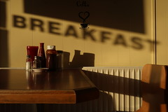 ready to eat (haemengine) Tags: shadow writing breakfast cafe food radiator sunlight table condiments wall