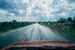 The devil is beating his wife. (M///S///H) Tags: rx1 driving drops newmexico newmexicotrue pointandshoot pov precipitation rain raining road sony sonyrx1 sunny taos