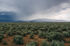 to the south. (M///S///H) Tags: 35mm rx1 clouds landscape mountains newmexico newmexicotrue outdoors outside pointandshoot rain raining sagebrush sony sonyrx1 taos