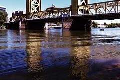 Reflections (Carrie McGann) Tags: sacramento sacramentoriver towerbridge bridge boat architecture 061819 nikon nikond850 interesting