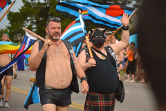 Out for a walk with the dog (radargeek) Tags: june 2017 okcpride pride gayprideparade parade oklahomacity okc flag beard dog mask leather