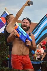 Watering the crowd (radargeek) Tags: june 2017 okcpride pride gayprideparade parade oklahomacity okc flag beard watergun cellphone
