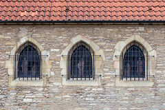 Keeping in or out? (A Different Perspective) Tags: 3 germany munster arch bars building church hidden orange roof statue stone tile window