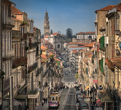 Porto Puzzle (Pietro Faccioli) Tags: porto portugal city downtown urban town traffic street road hill steep houses building typical old traditional tram windows perspective compression telephoto church sky horizon blue sunny day balcony cityscape