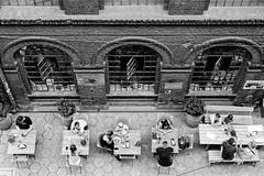 conversations (radek_k_) Tags: people outside old building street streetphoto streetphotography olympus omd mzuiko blackandwhite bw bnw łódź poland lodz