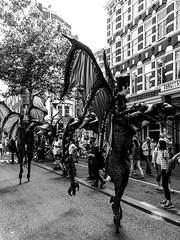 Street Parade Spui Straat BW III (CloudBuster) Tags: add tags feestje 2019 juni 16 straatfeest party street spui iamsterdam amsterdam i city capital the netherlands history buildings public dragon draak parade actors performance show glamour glitter blue blauw costume kostuum optreden tourism sightseeing clouds sunshine beauty visit zondagmiddag stad