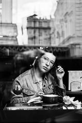 Behind the window (_storysofar_) Tags: streetphotography streetportrait people girl portrait window reflection cafe city blackandwhite monochrome buildings glasses moscow russia fujifilm