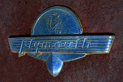 Plymouth (davidwilliamreed) Tags: old rusty crusty metal chrome plymouth emblem marque badge abandoned neglected forgotten rust decay weathered weatherbeaten oxidized oxidation oldcarcity whitega bartowcounty patina