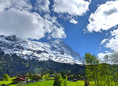 Grindelwald,Switzerland (Sylvia Okkerse) Tags: alpine mountaineering alpinism mountainvillage tourism mountaineer mountainclimber houses trees waterfall snow snowcapped bluesky clouds cloudy grindelwald berneroberland zwitserland switzerland suisse svizzera