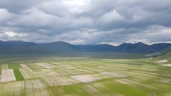 Pian Grande di Castelluccio (Eternally Forgotten) Tags: umbria italy italia italien italian province region perugia norcia castelluccio piangrande countryside hills hilly mountains apennines clouds cloudy sea nature natural environment land landscape distant horizon darkness veiled spring agriculture massive calm peace serenity tranquillity charming beautiful cold loneliness wanderlust journey travel tourism trip discovery voyage adventure exploring hiking wandering magic spell enchanting memories recollections lovely dreams melancholy yearning nostalgia reminiscence