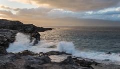 Boom (Austin Westervelt) Tags: hawaii maui island beautiful light sunset sunlight rocks rocky coast shore coastline sea ocean water waves sky clouds
