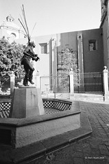 native (markjwyatt) Tags: zeisscontaxiia voigtlanderscskopar21mmf4 ilford hp5 film monochrome queretaro mexico statue native headdress fountain church cathedral cross
