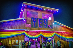 Plaza 3 (House of Yes & Little Cinema), 2019.06.14 (Aaron Glenn Campbell) Tags: plaza houseofyes littlecinema pridecolors rainbow bonnaroo musicfestival coffeecounty manchester tn tennessee evening night building structure lights outdoors optoutside nikcollection colorefexpro viveza sony a6000 ilce6000 mirrorless sigma 19mmf28exdn primelens wideangle emount bonnaroo2019