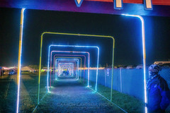 VIP Exit / Entrance (Light Tunnel), 2019.06.14 (Aaron Glenn Campbell) Tags: bonnaroo musicfestival coffeecounty manchester tn tennessee evening night campground tents vehicles vip lights outdoors optoutside nikcollection colorefexpro glamourglow softfocus sony a6000 ilce6000 mirrorless sigma 19mmf28exdn primelens wideangle emount
