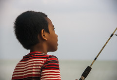 The fishing boy 2 (Out Of The Map) Tags: malaysia penang outofthemap fishing family sunday asia playing kid