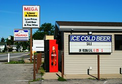 Mega Liquor & Smoke - Nappanee, Indiana (Cragin Spring) Tags: indiana midwest unitedstates usa unitedstatesofamerica smalltown megaliquorsmoke zimnepiwo beer sign coke cocacola cokemachine liquor liquorstore store hamms hammsbeer nappanee