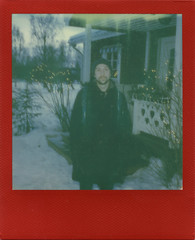 Christmas Fade (Magnus Bergström) Tags: polaroid polaroid680slr polaroidoriginals polaroidslr680 instant film instantfilm red metallic redmetallic 600 sweden värmland wermland portrait christmas xmas ekshärad västanberg hagfors