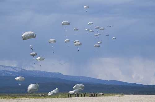 Soldiers complete a static line jump from a U.S. Air Force C-130 Hercules during RED FLAG-Alaska