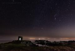 A Light In The Black (ianrwmccracken) Tags: sirius night d750 landscape nikkor1635mmf4 orion fife silhouette figure dark starg astronomy sky riverforth nikon coast heavens constellation