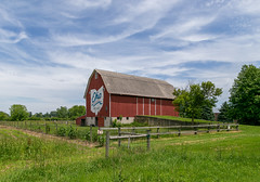 Barn — Huron Township, Erie County, Ohio (Pythaglio) Tags: barn building structure historic outbuilding threebay foundation bank raisedbasement ramp gambrel roof mural bicentennial painted red verticalboards doors fence grass trees clouds bluesky hurontownship eriecounty