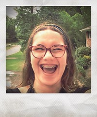 Granddaughter Ariella takes a Stealthy Selfie with my iPhone! (steveartist) Tags: iphonese snapseed instantapp girls teenagers ariella smiles selfies eyeglasses braces californiagirls fakepolaroids mariettaga trees grass house