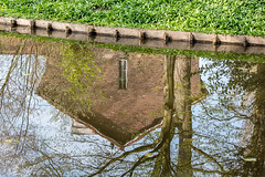 Anti-gravity (A Different Perspective) Tags: amstelveen amsterdam holland netherlands brick canal grass green house reflection ripple river tree upsidedown window