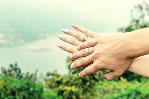 Honeymoon hands on the tropical lake background. Bali island.