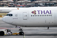 Thai Airways - Boeing 777-3DZ(ER) / HS-TKW @ Manila (Miguel Cenon) Tags: tg tg777 tg77w thai thaiairways thai777 thai77w airplanespotting airplane apegroup appgroup airport rpll boeing boeing777 boeing77w b777 b77w manila nikon naia d3300 wide widebody wings widebodyjet jet ge90 ppsg planespotting philippines sky fly flying twinengine aircraft cockpit hstkw aviation wing window wheel plane