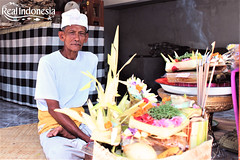 A local with the Offerings (Real Indonesia) Tags: bali indonesia local culture flower offerings canang sari