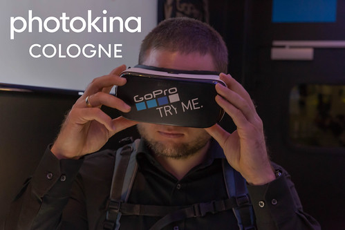 Photo fair visitor tests the VR glasses by GoPro, next to the picture title