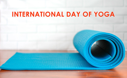 Blue Roll-Up Yoga Mat on a White Background, for fitness and meditation, with the title