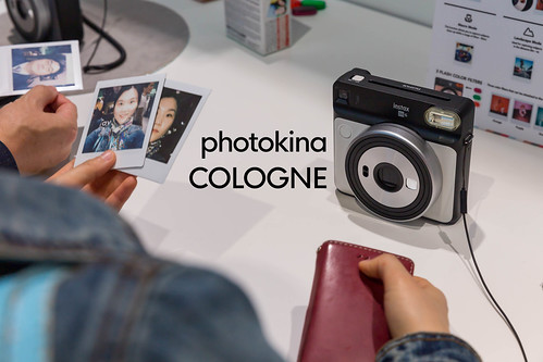 Polaroids made with the Instax sq 6 photo camera, next to the picture title
