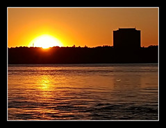 Sunset On The Ottawa River (bigbrowneyez) Tags: sunset beautiful golden dof ottawariver remicrapids building reflection bello bellissimo fumo river sole cielo sky sun water nature natura aqua canada ontario local fantastic striking stunning pretty eyecatching oro ripples glowing glorious goldenhour sunsetontheottawariver romantic ambiance mood silhouette