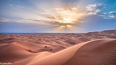 Sunset over the desert (patuffel) Tags: arabia laurence sunset burst sunburst sunrails sun sahara morocco marokko dune dunes sand mountains leica m10 28mm summicron erg chebbi merzouga