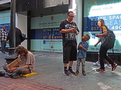BostonManinMiamiTee (fotosqrrl) Tags: boston massachusetts streetphotography urban winterstreet boy maninneed