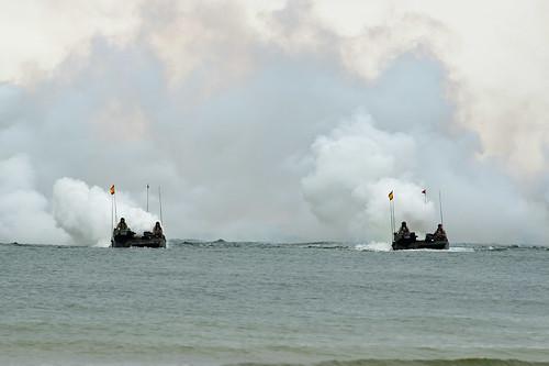 Spanish amphibious assault vehicles create a smoke screen as part of an amphibious assault for exercise Baltic Operations (BALTOPS) 2019.