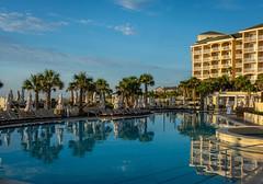 Omni Amelia Island Resort Pool (JavaJoba) Tags: ameliaisland pool omniameliaisland resort florida reflections morning water sky palmtrees fernandinabeach resortpool hotelpool poolchairs