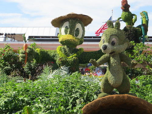 Green Statues of Disney Characters Made of Grass in Epcot Park