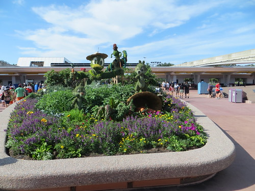 Green Statues of Disney Characters Made of Leaves in Epcot Park